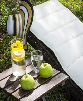 Refreshments and fruits placed next to the Mary An luxury apartments sun loungers.