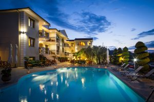 The Mary An Luxury, boutique apartments in Thassos swimming pool against the evening sky.
